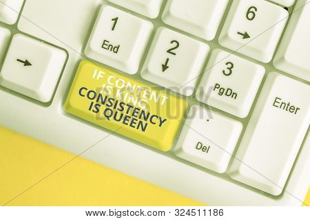 Writing note showing If Content Is King Consistency Is Queen. Business photo showcasing Marketing strategies Persuasion White pc keyboard with note paper above the white background. stock photo