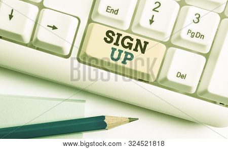 Writing note showing Sign Up. Business photo showcasing use your information to register in website team college or blog White pc keyboard with note paper above the white background. stock photo