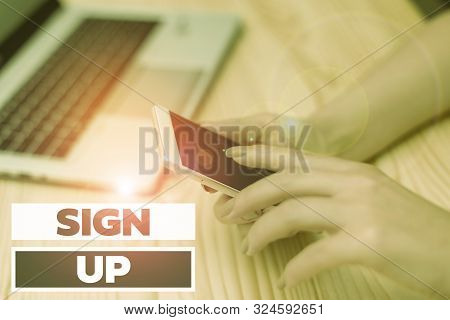 Handwriting text writing Sign Up. Concept meaning use your information to register in website team college or blog woman laptop computer smartphone mug office supplies technological devices. stock photo