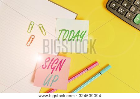 Text sign showing Sign Up. Conceptual photo use your information to register in website team college or blog Empty blue paper with copy space paper clips and pencils on the yellow table. stock photo