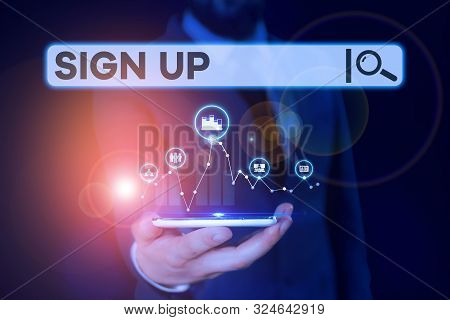 Conceptual hand writing showing Sign Up. Business photo showcasing use your information to register in website team college or blog Male wear formal suit presenting presentation smart device. stock photo