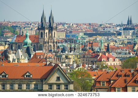 April sunny day over the roofs of old Prague. Czech stock photo