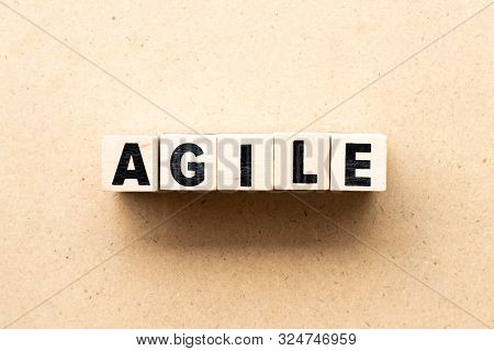 Letter block in word agile on wood background stock photo