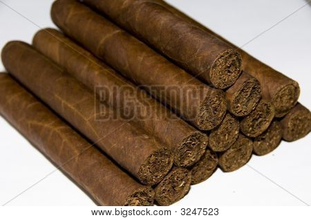 Great looking stack of premium hand rolled cigars ready for selection and smoking ** Note: Shallow depth of field stock photo