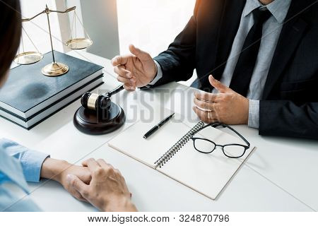 lawyer in office. Counseling and giving advice about legal legislation in courtroom to help customer, tribunal and justice concept. stock photo