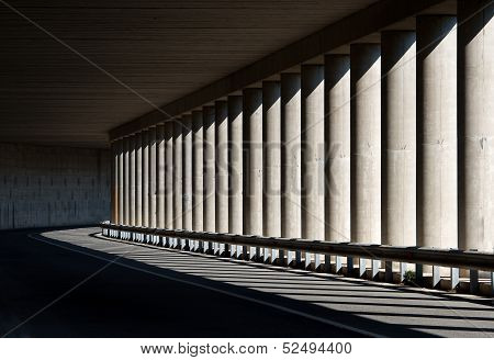 Road in the mountains, mountains road in Sardinia, Nuoro province, bridge arch and columns detail, fragment of road in the mountains, architectural element, bridge columns, shadows, construction stock photo
