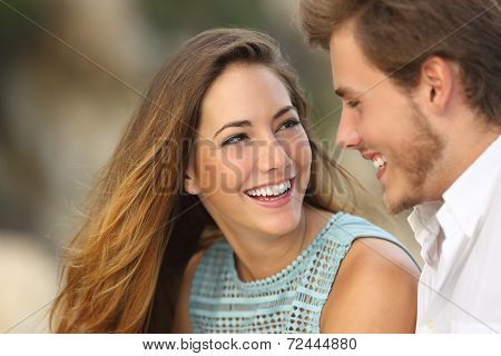 Funny Couple Laughing With A White Perfect Smile
