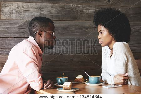 Love And Friendship Concept. Beautiful African Young People Having A First Date At A Restaurant, Dri
