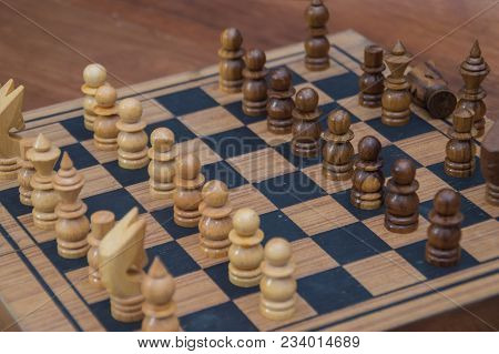 Leadership Concepts. Chess is a leader.  Comparing chess is a strategic business plan. Businessman is playing chess. Chess game on a black background. stock photo