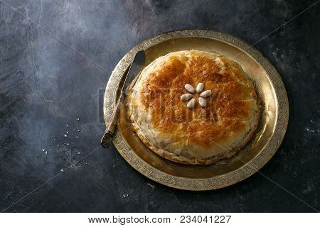 Moroccan bastilla on copper palte, space for wording. stock photo