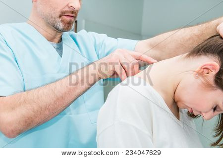 Close Up Male Neurologist Doctor Examines Cervical Vertebrae Of Female Patient Spinal Column In Medi
