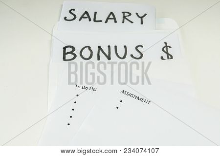 business concept - isolated bonus and salary evaluation based on assignment and goal for employee performance review stock photo