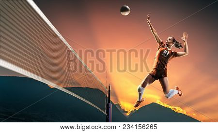 Professional female volleyball player in action on the court stock photo