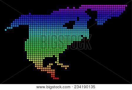 Spectrum dotted pixel North America Map. Vector geographic map in bright colors on a black background. Color vector pattern of North America Map designed of dot elements. stock photo
