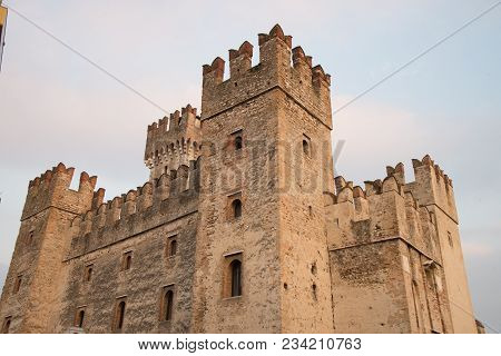 Castle Sirmione on lake Garda, Italy. The famous castle of Sirmione, which dates back to the Scaliger Lords of Verona, and its small port still perfectly preserved are an uncommon example of a fortress used as a port. stock photo