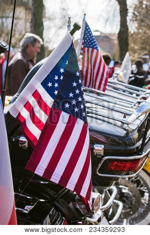 USA Flags are displayed at the back of motorbike on Czech Motor season opening. Close up view stock photo