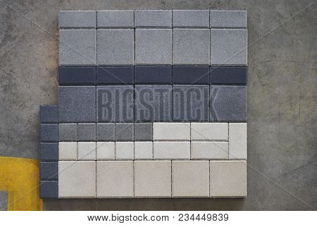 Concrete road curbs at the factory for the production of cement products, paving slabs stock photo
