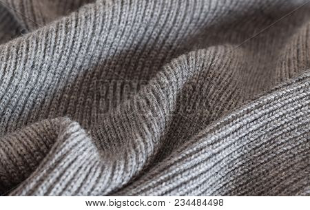 Knitted sweater folded material closed up background stock photo