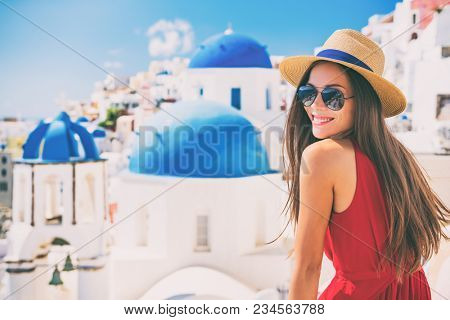 Travel Europe summer holiday girl enjoying Oia, Santorini Greece cruise vacation. Sun getaway Asian