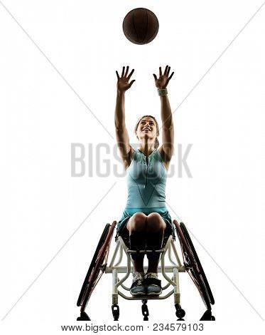 one caucasian young handicapped basket ball player woman in wheelchair sport tudio in silhouette isolated on white background stock photo
