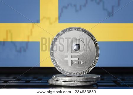 PETRO (PTR) cryptocurrency; coin el petro on the background of the flag of Sweden (Kingdom of Sweden); national Venezuela cryptocurrency stock photo