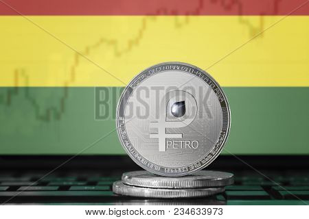 PETRO (PTR) cryptocurrency; coin el petro on the background of the flag of BOLIVIA; national Venezuela cryptocurrency stock photo