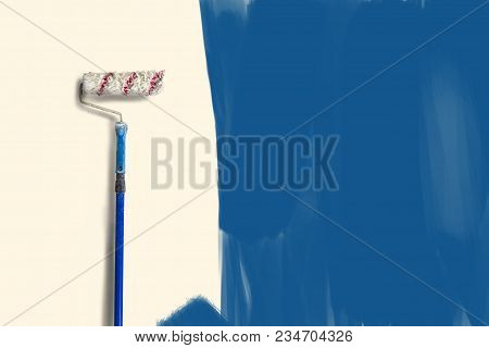 Scene of apartment repair. Roller for painting on a long handle against the background of an under-painted wall. Concept Painting work. stock photo