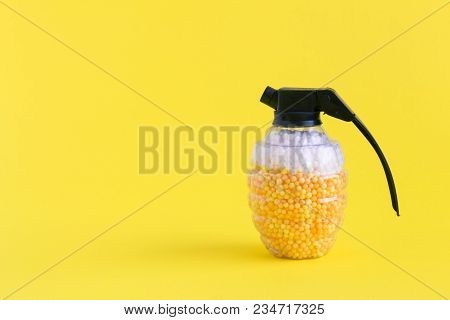 Hand grenade toy bomb full of foam balls in form of beer and foam minimal creative concept. Space for copy. stock photo