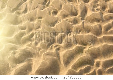 Beige background. Background of sand. Beautiful waves and sand dunes. A desert with beautiful waves. Design with copy space. stock photo