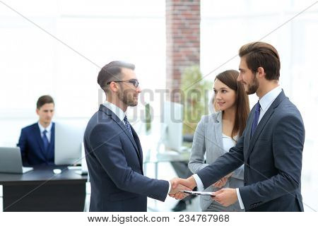 Young man introducing himself at meeting to his partners. stock photo
