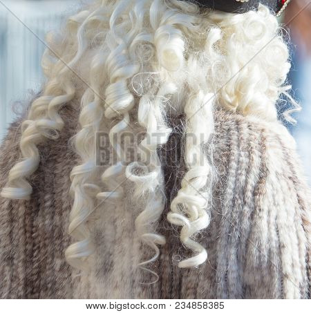 White fluffy fur on wig as background . stock photo