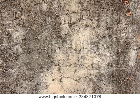 Old flaky paint peeling off grungy cracked wall. Cracks, scrapes, peeling old paint and plaster on background of old cement wall. Old cement stone beige wall vintage cracked. Design with copy space. stock photo