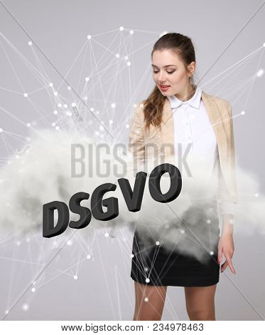 DSGVO, german version of GDPR, concept image. General Data Protection Regulation, protection of personal data. Young woman working with information. Datenschutz-Grundverordnung. stock photo