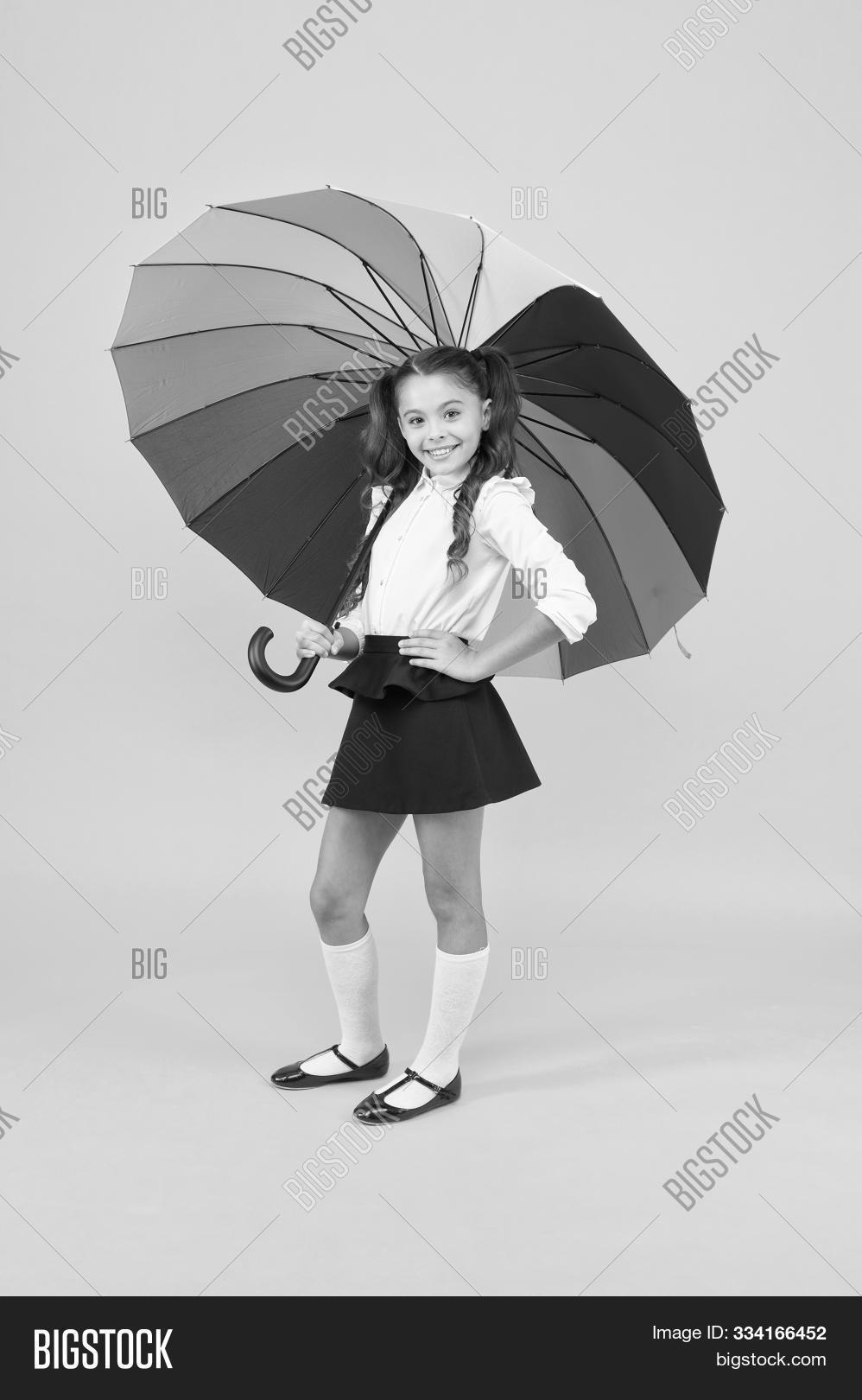 accessory,adorable,autumn,baby,background,beauty,brunette,casual,charm,charming,child,childhood,color,colorful,cute,design,equipment,fall,fashion,fashionable,gear,girl,glamor,glamorous,glamour,gorgeous,hair,kid,little,long,look,lovely,multicoloured,pretty,rain,rainbow,school,schoolchild,schoolgirl,small,style,stylish,trend,trendy,umbrella,yellow