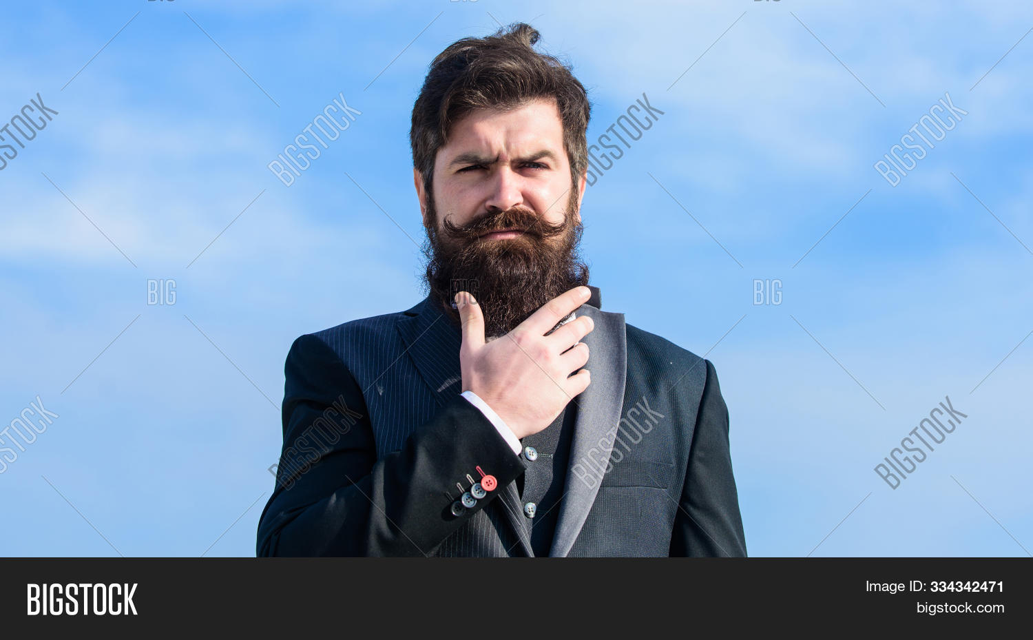 Vintage style long beard. Facial hair beard and mustache care. Beard fashion trend. Invest in stylish appearance. Grow thick beard fast. Man bearded hipster wear formal suit blue sky background