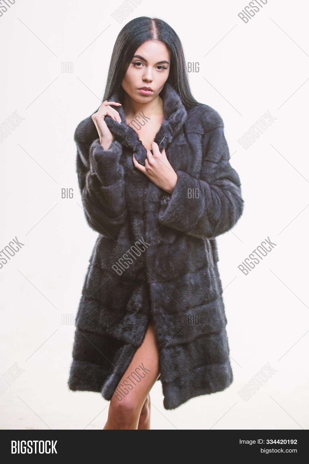 Girl elegant lady wear fashionable coat jacket. Luxurious fur. Woman attractive model wear dark soft coat. Fashion concept. Female with makeup wear mink black fur coat. Girl posing fur coat