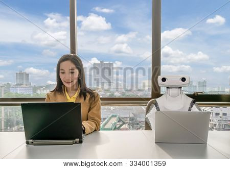 Working Women And Robot Computers In The Office Business Rpa Robotic Process Automation