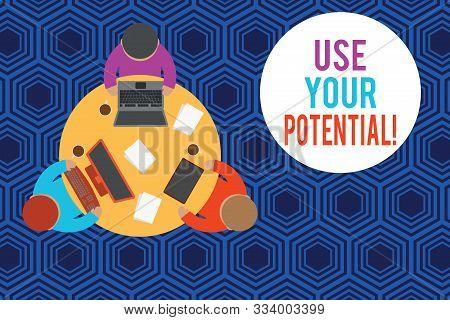 Writing note showing Use Your Potential. Business photo showcasing achieve as much natural ability makes possible Working table male employees electronic devices coffee cup. stock photo