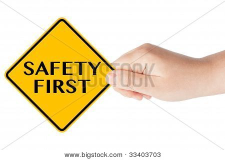 Safety First traffic sign with hand on the white background stock photo