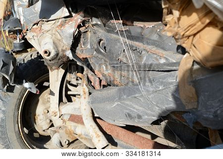 Part of an old abandoned car that had an accident in close-up stock photo