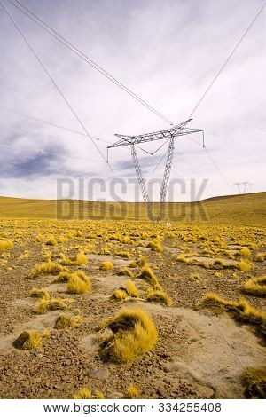 Power lines towers in the Altiplano (high Andean plateau) at 4200 meters over the sea level, Atacama desert, Antofagasta Region, Chile, South America stock photo