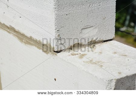 Laying autoclaved aerated concrete blocks for house wall. Close up on laying blocks stock photo