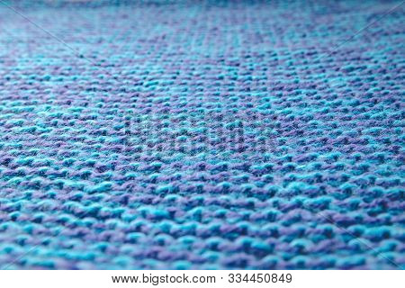 Blue knitted background. Knitted texture. A sample of knitting. Knitting Pattern. stock photo