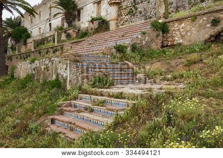 Staircase of Kasbah in Tetouan (Northern Morocco). In Morocco kasbah frequently refers to multiple buildings in a keep, a citadel, or several structures behind a defensive wall. stock photo