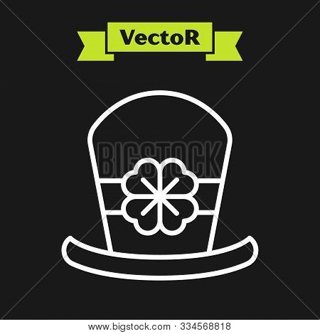 White line Leprechaun hat and four leaf clover icon isolated on black background. Happy Saint Patricks day. Vector Illustration stock photo