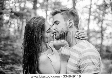 Couple in love kissing with passion outdoors. Man and woman attractive lovers romantic kiss. Passionate kiss concept. Giving kiss. Seduction and foreplay. Sensual kiss of lovely couple close up stock photo