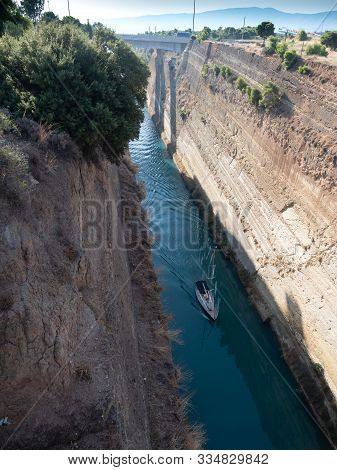 A sleek yacht sailing through the Corinth Canal in the Isthmus of Corinth in Greece stock photo