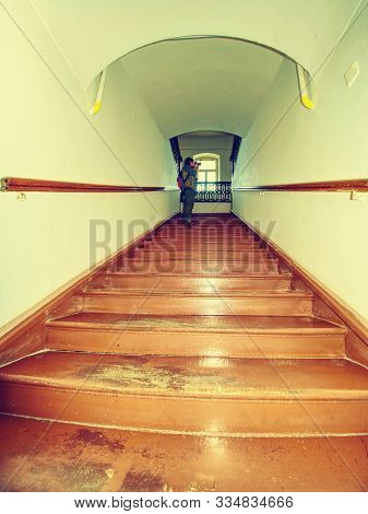 Renewal brown wooden oak staircase with railing in same paint, renovated apartment interior and old ladder stairs. stock photo