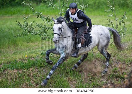 MOSCOW - JUNE 02: Unidentified rider on horse is overcomes the obstacle at the International Eventing Competition CCI3*/2*/1*