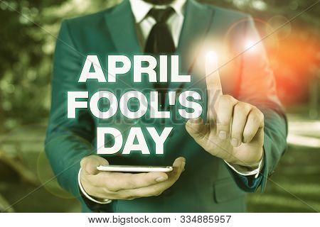Conceptual hand writing showing April Fool S Day. Business photo showcasing Practical jokes humor pranks Celebration funny foolish Businessman with pointing finger in front of him. stock photo